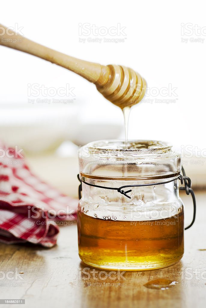 Antique Jar of Honey and Dipper with Copy Space stock photo