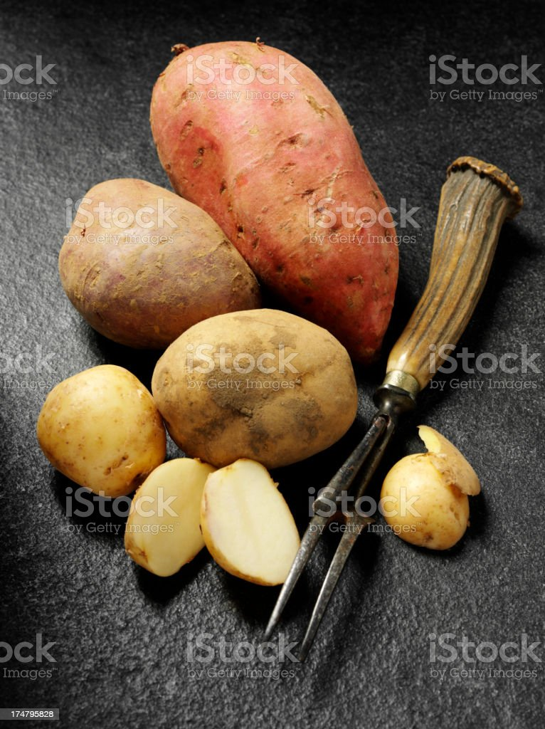 Antique Kitchen Fork with a Group of Mixed Potatoes royalty-free stock photo