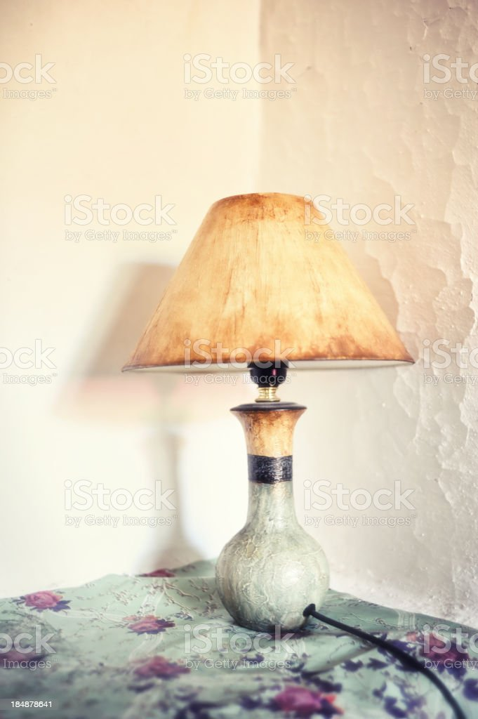 Antique lamp shade in wall niche royalty-free stock photo