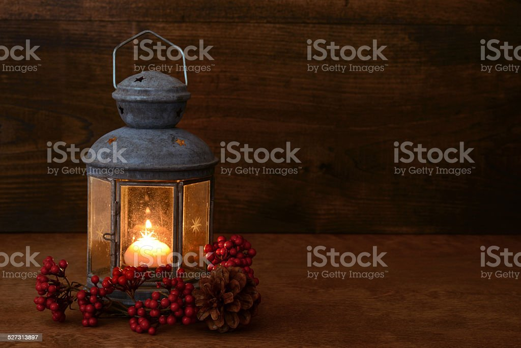 antique lantern with red berries stock photo