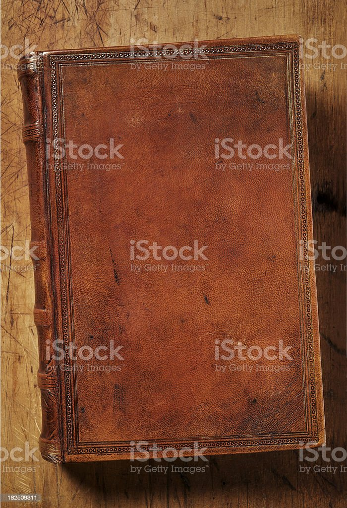 Antique Leather Book on Old Desktop royalty-free stock photo
