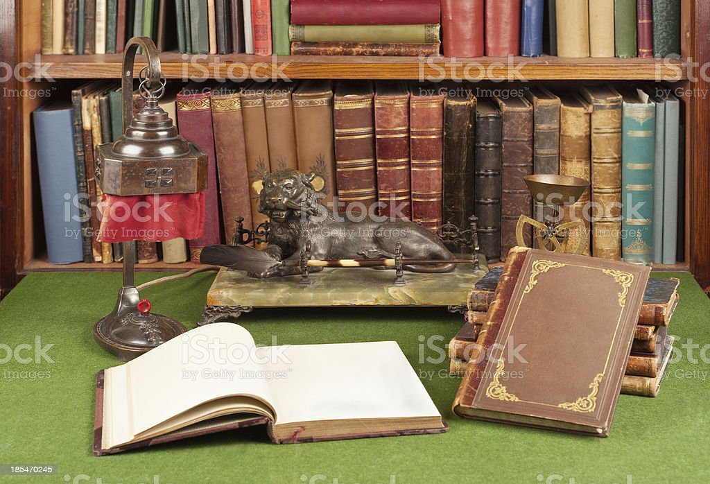 Antique leather books, lamp and reading glasses royalty-free stock photo