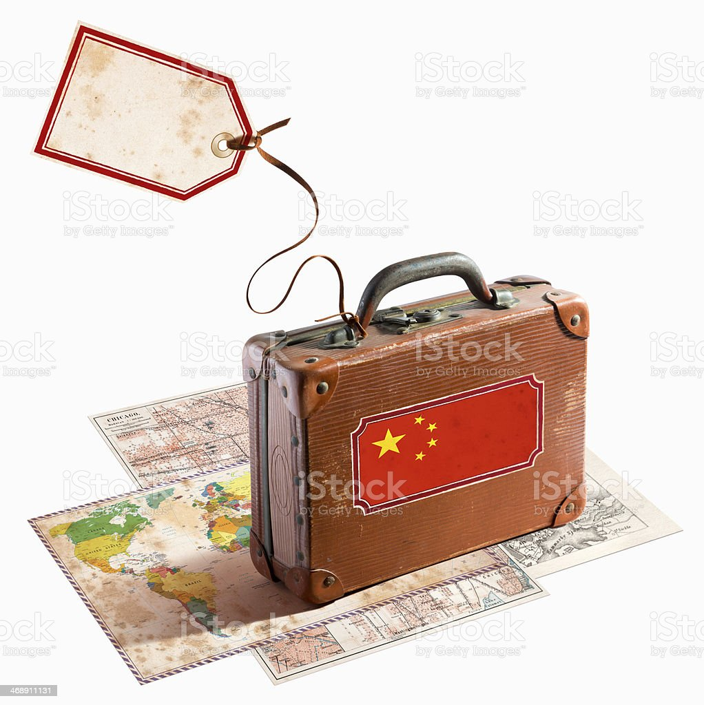 Antique leather suitcase on different maps China Flag royalty-free stock photo