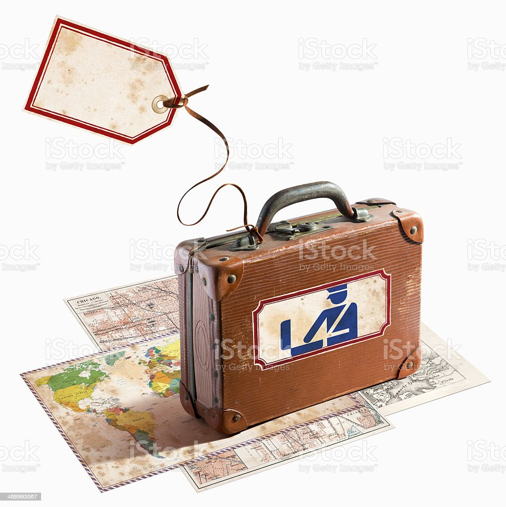Antique leather suitcase on different maps with customs label royalty-free stock photo