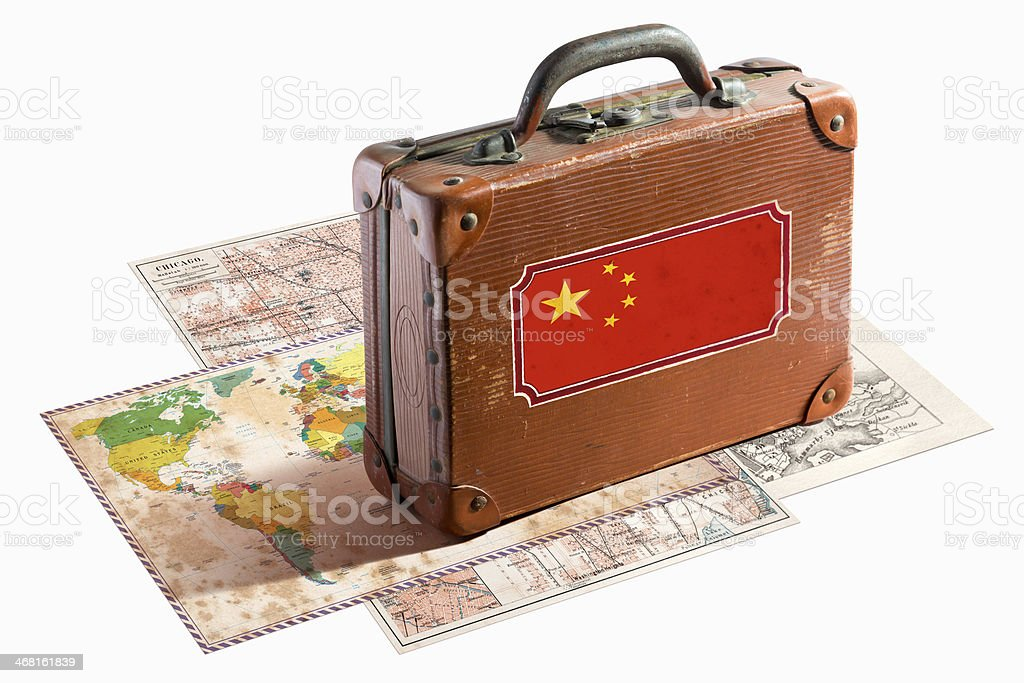 Antique leather suitcase with China flag on maps royalty-free stock photo