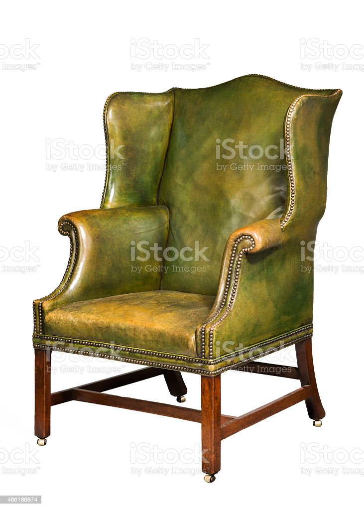 antique leather wing chair isolated stock photo