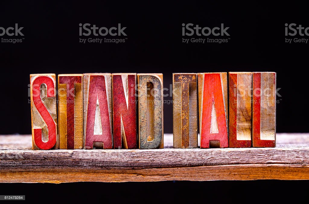 Antique Letterpress Woodblock Letters Spelling STAND TALL stock photo