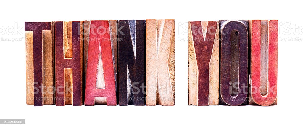 Antique Letterpress wooden letters spelling THANK YOU stock photo