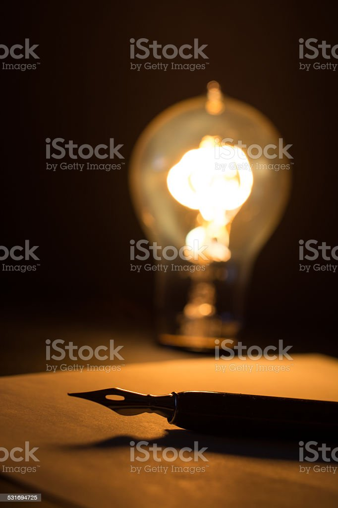 Antique Light Bulb and Antique Pen stock photo