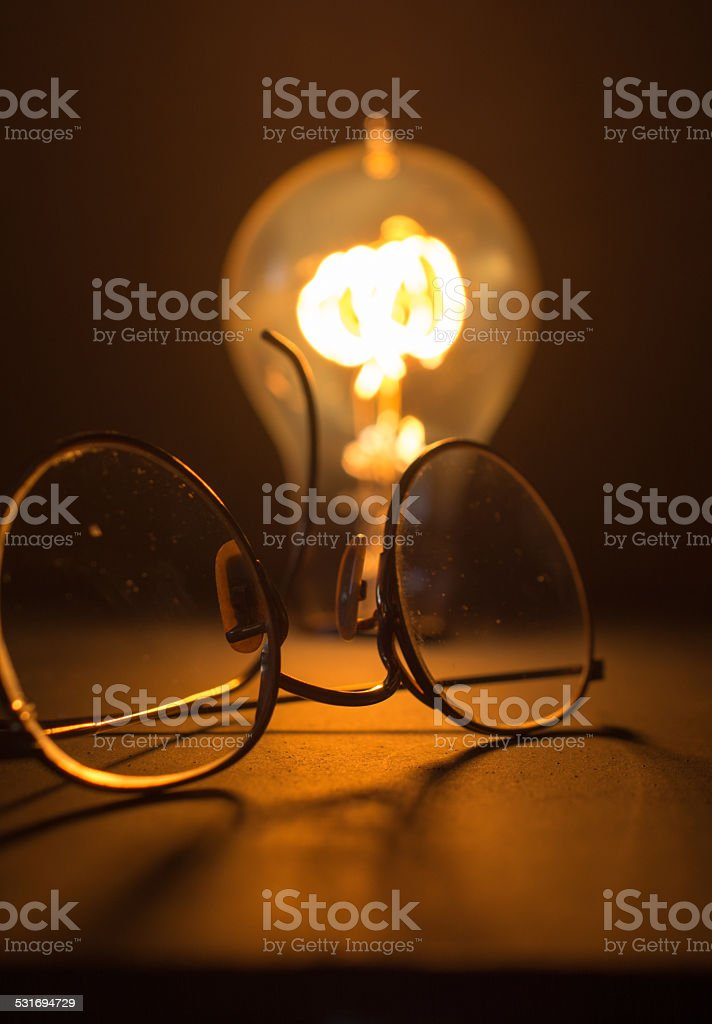 Antique Light Bulb and Glasses stock photo