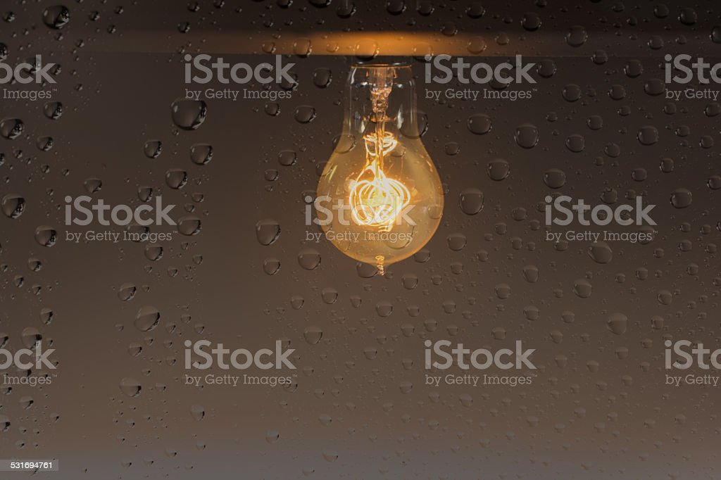 Antique Light Bulb and Rain stock photo