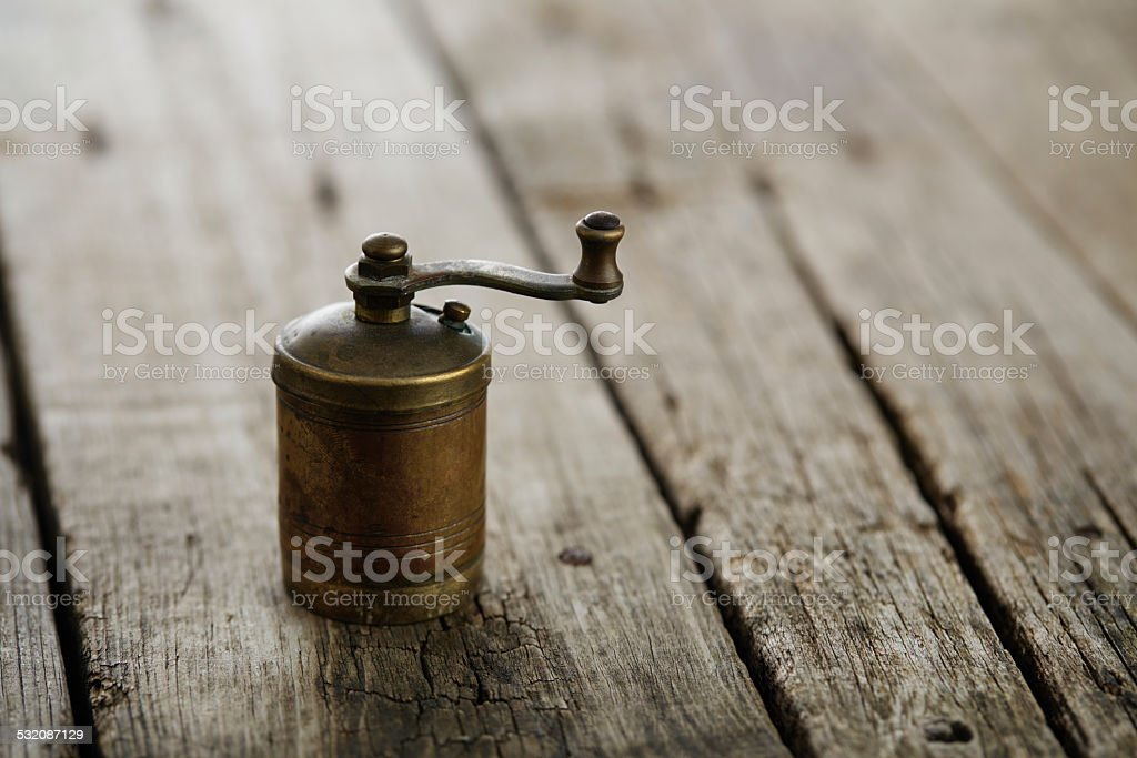 Antique manual pepper mill stock photo