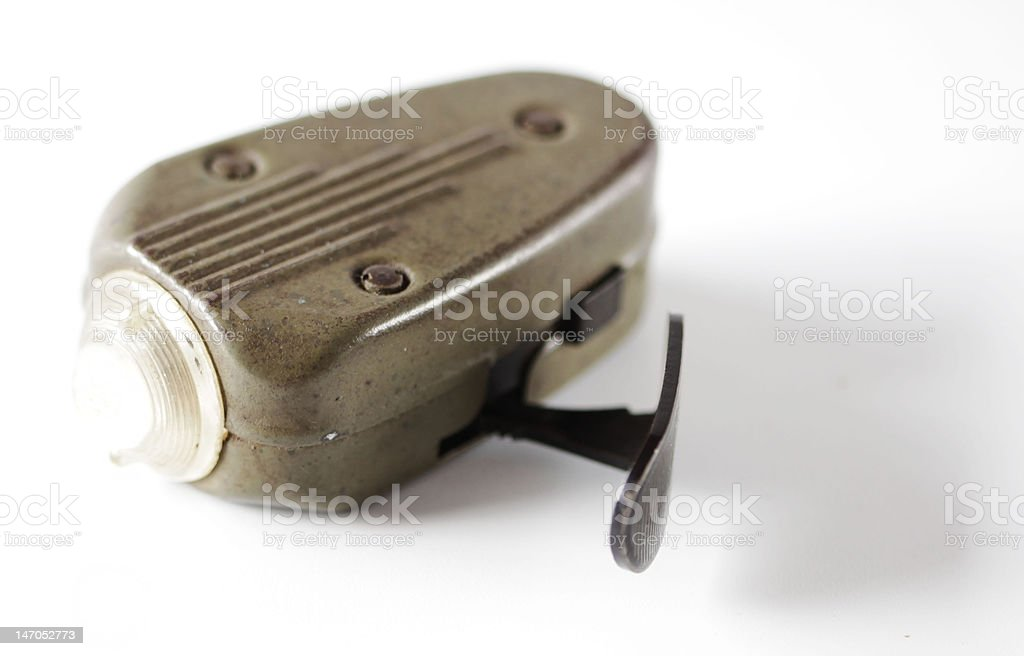 Antique manual squeeze torch light using self made energy. stock photo