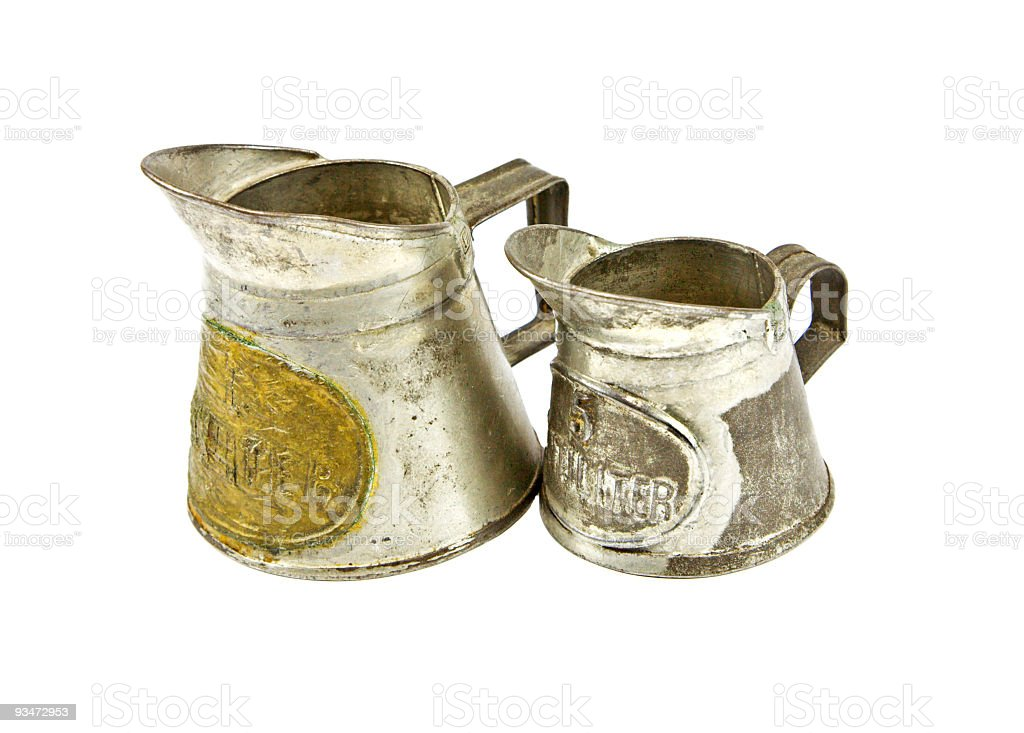 Antique measuring jugs for the kitchen stock photo