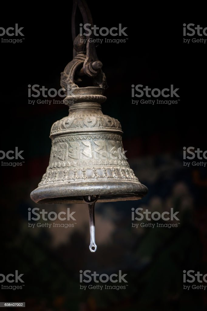 Antique metal bell in a Buddhist monastery stock photo