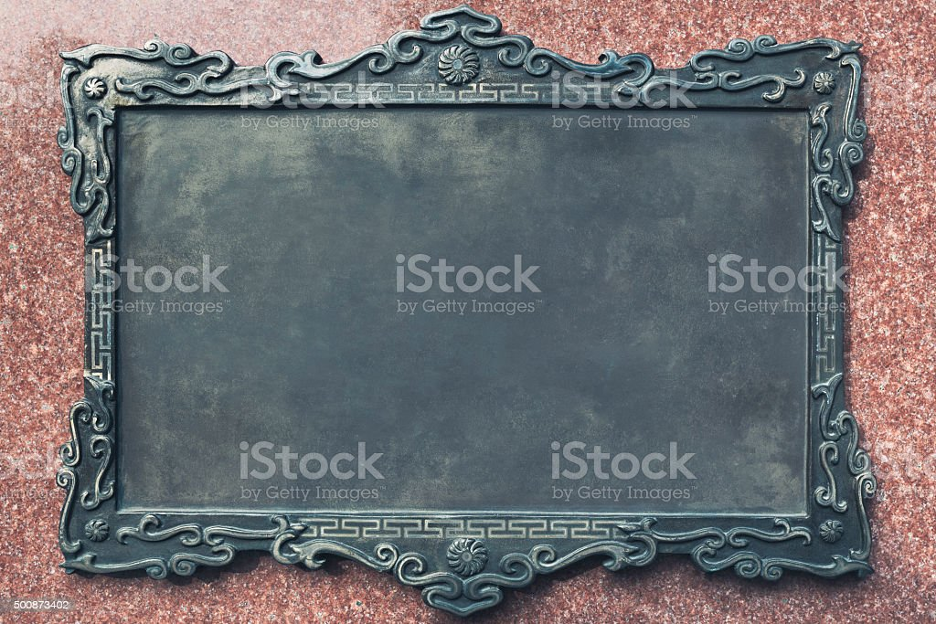 Antique metal plaque stock photo