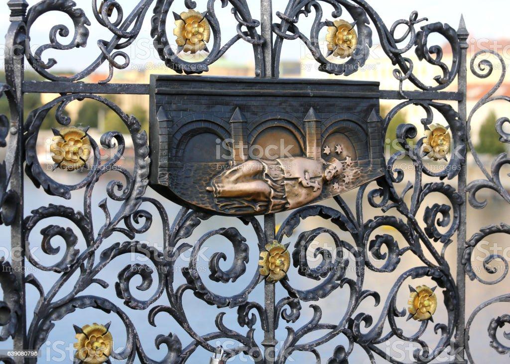 antique metal statue of St. John Nepomucene stock photo