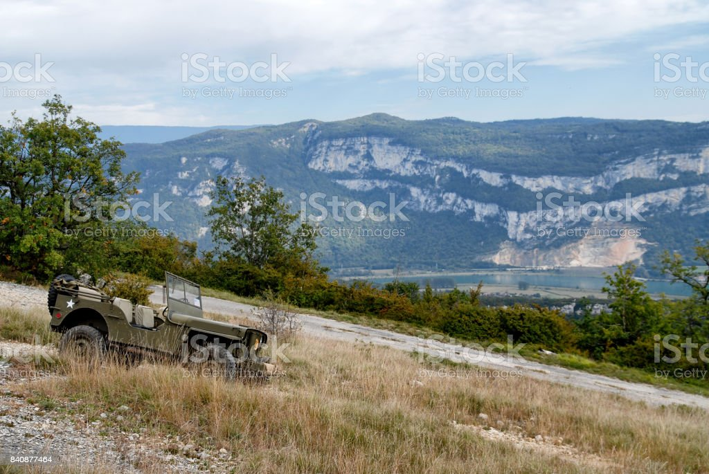 antique military vehicle in the mountain stock photo