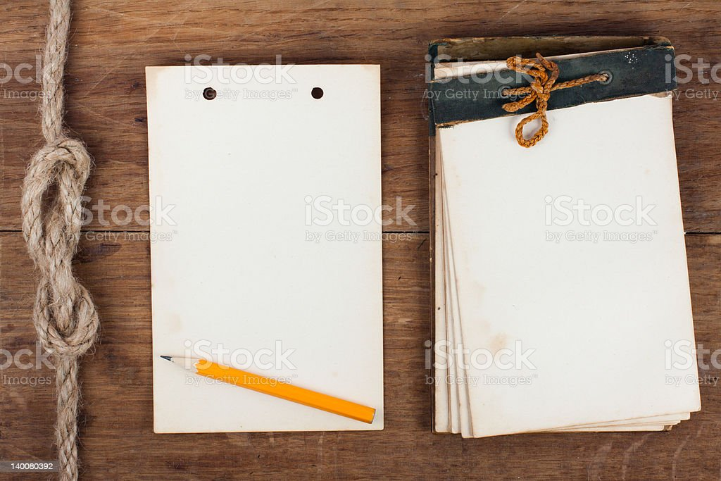 Antique notebook (1940th) and its page on wood background royalty-free stock photo