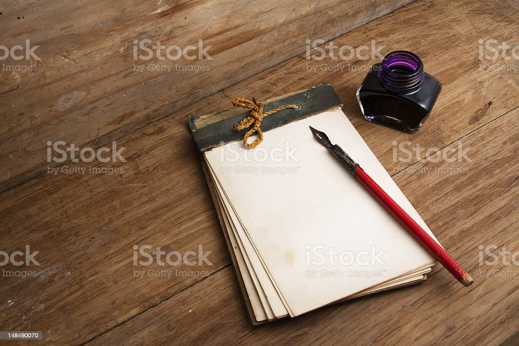 Antique notebook (1940th), ink pen and inkwell on wood royalty-free stock photo