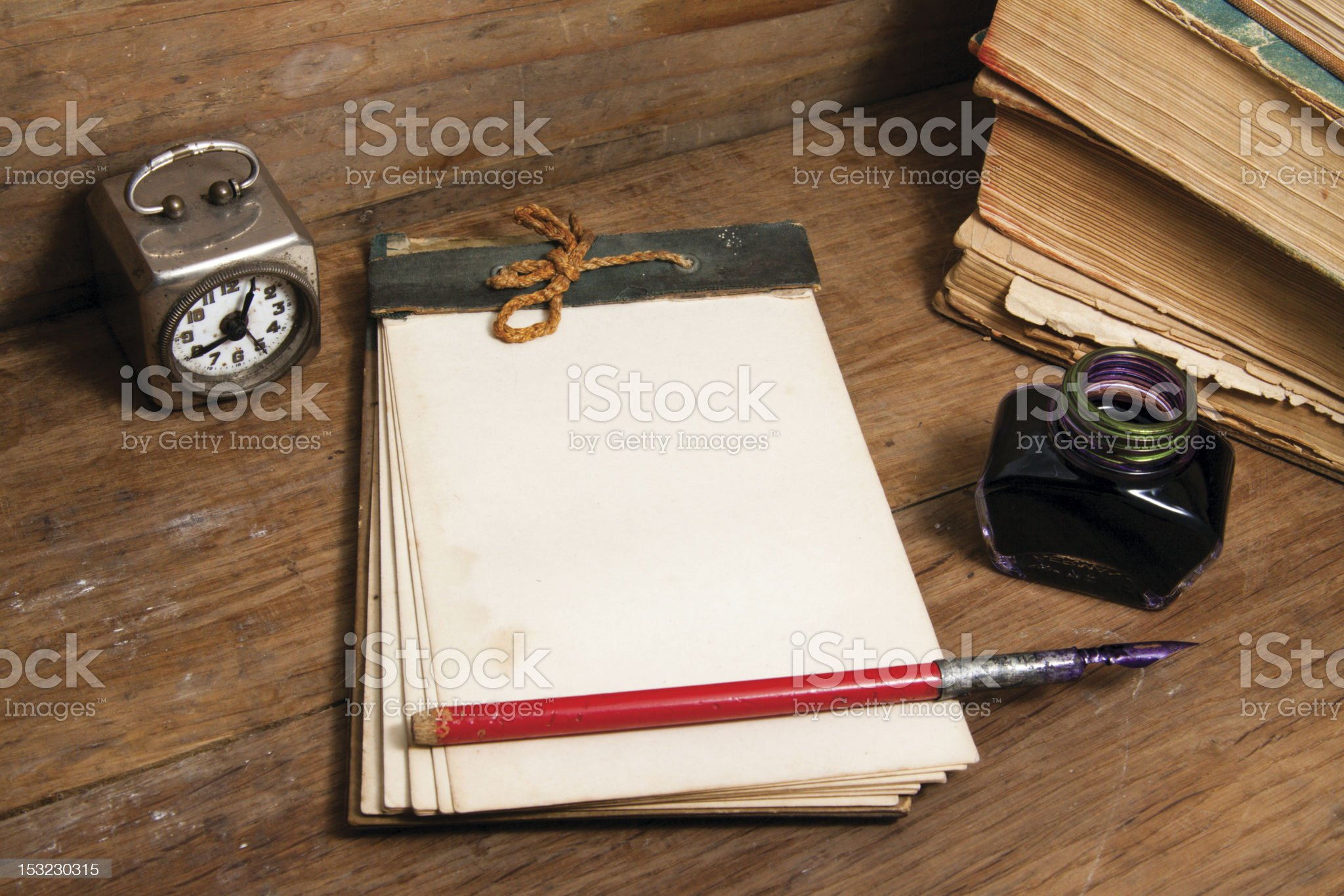 Antique notebook, vintage clock, ink pen and inkwell royalty-free stock photo