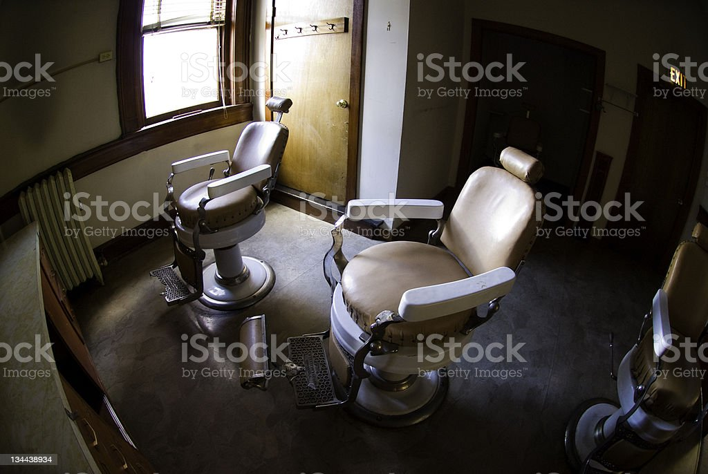 Antique Old Barber Chair with Nice Window Light royalty-free stock photo