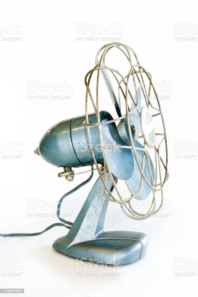 Antique Old Fashioned Retro Electric Fan on White Side View royalty-free stock photo