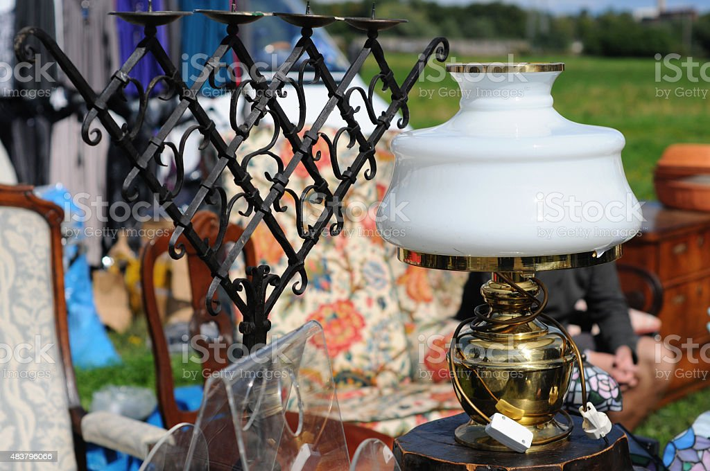 Antique old lamp with iron candle holder in background. stock photo