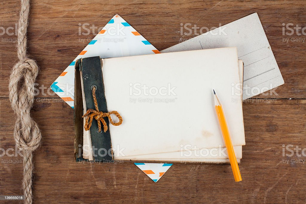 Antique Old Notebook (1940th), pencil and envelope on wood background royalty-free stock photo