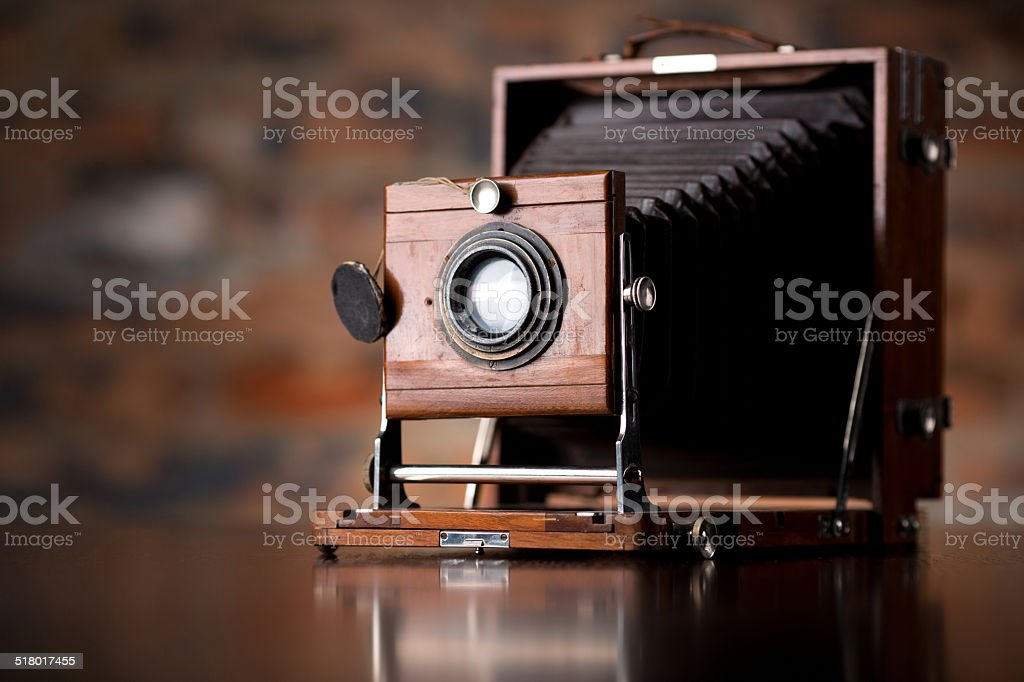 Antique Old photo Camera on wooden table stock photo