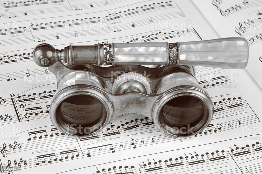 Antique Opera Glasses on a Music Score royalty-free stock photo