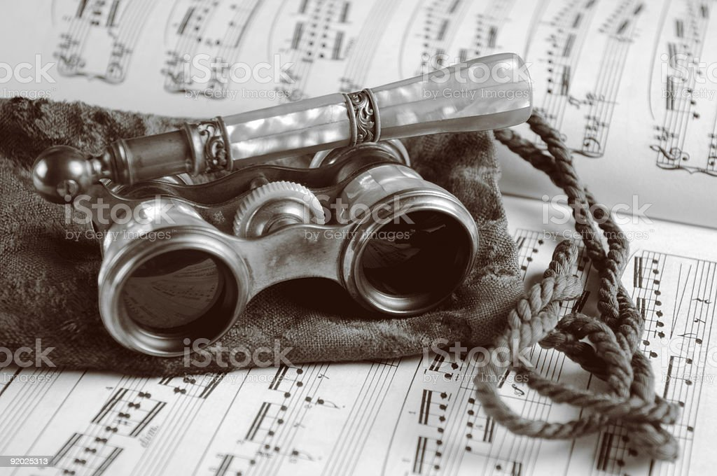 Antique Opera Glasses on Sheet Music royalty-free stock photo