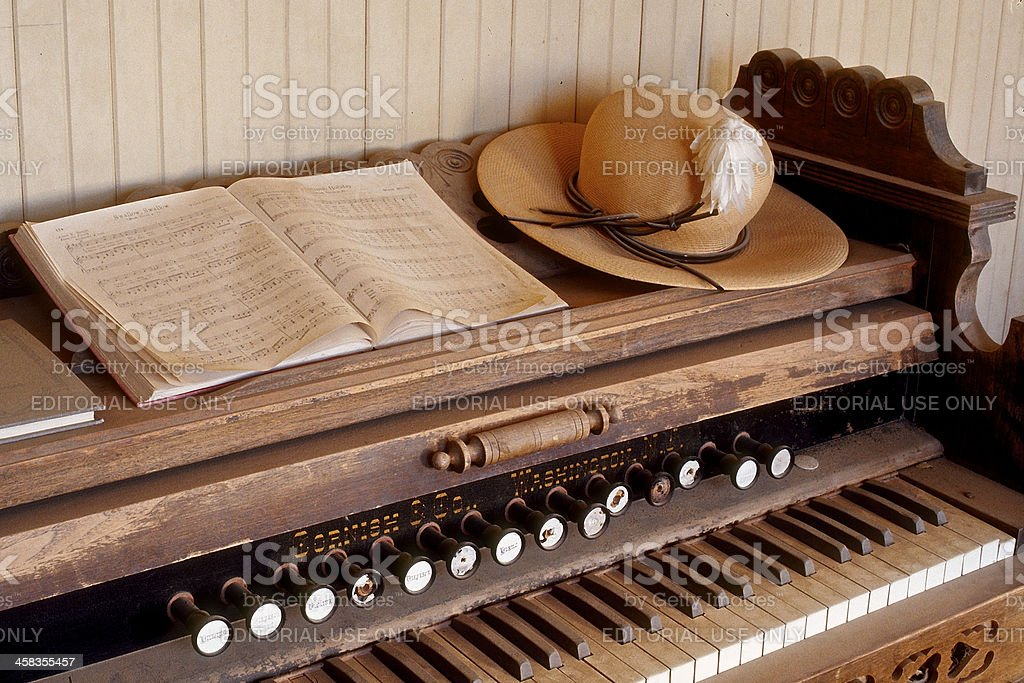 Antique Organ Bodie California School House with Music Book Hat stock photo