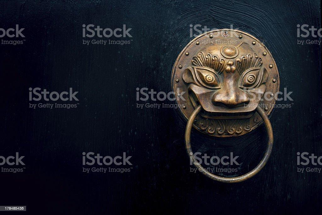 antique oriental door knocker stock photo