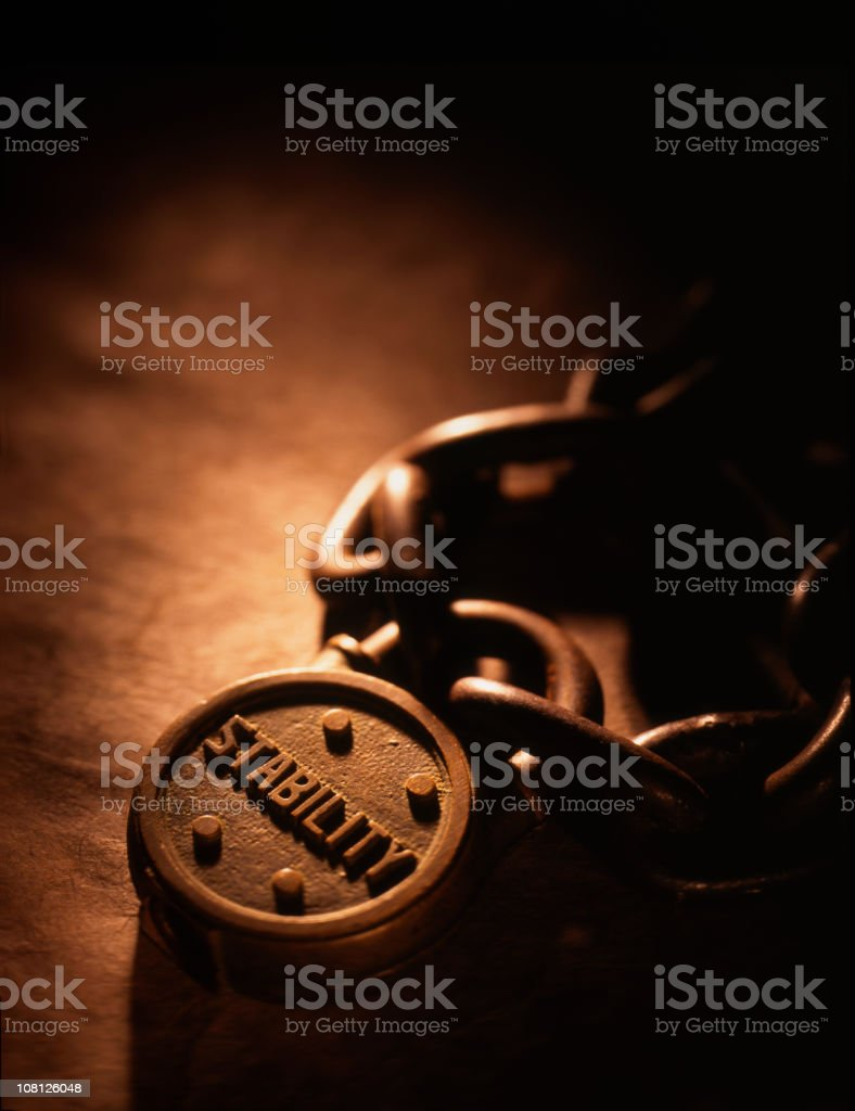 Antique Padlock and Chain with the word 'Stability' royalty-free stock photo