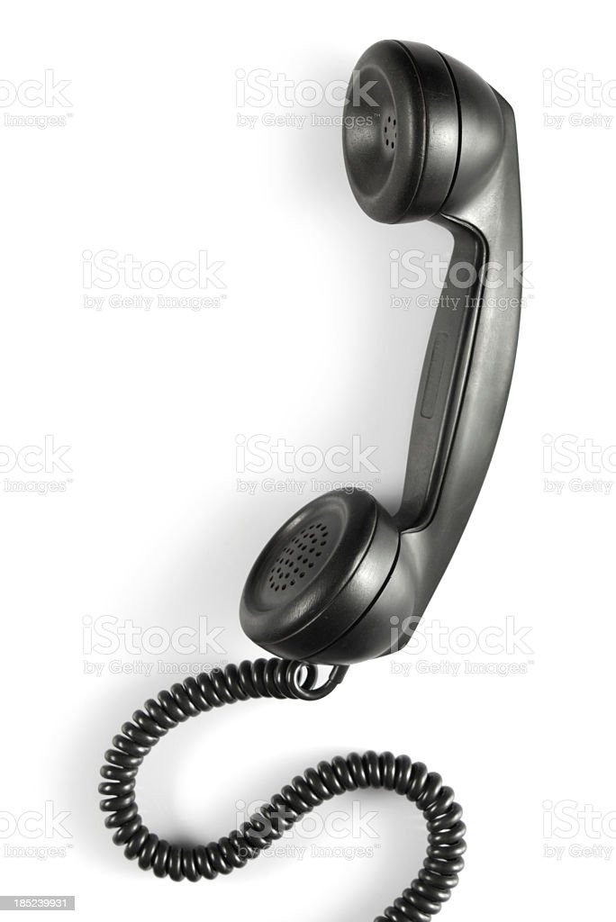 Antique phone handset with cord in the color black stock photo