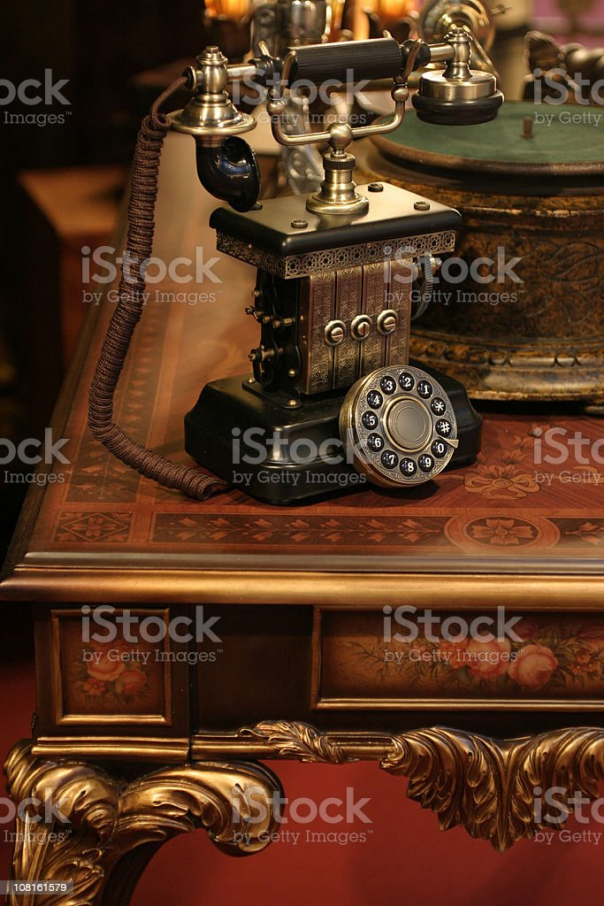 Antique Phone on Victorian Style Table stock photo