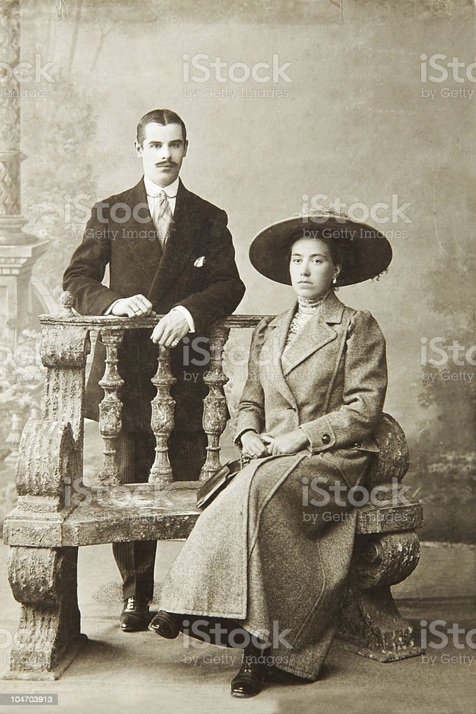 Antique photo of a woman seated and a man standing royalty-free stock photo