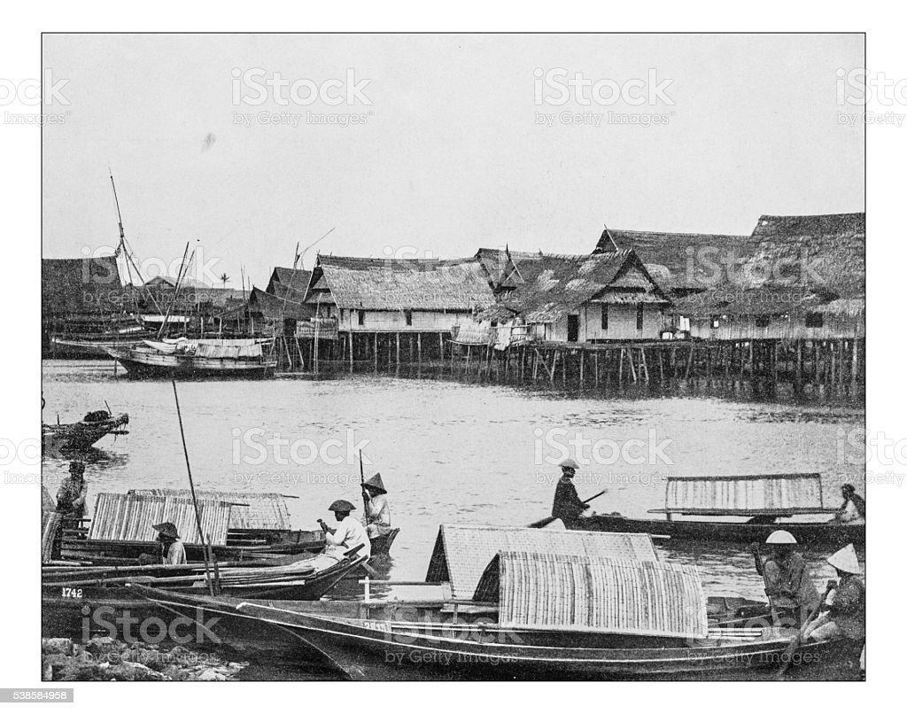 Antique photograph of native Malay village during the 19th century stock photo