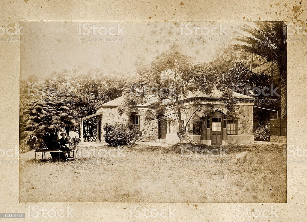 Antique Photograph of Old House with Young Girl Outside stock photo