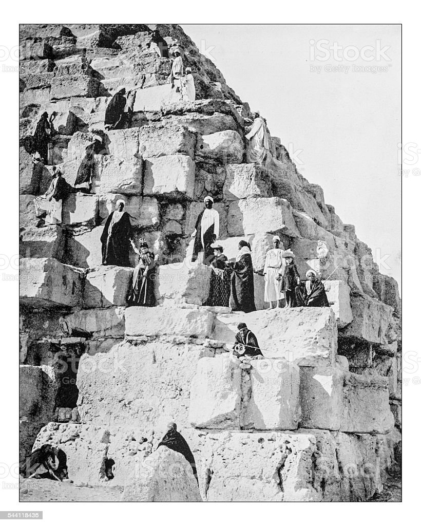Antique photograph of tourists ascending the Gyza Pyramid (Egypt-19th century) stock photo