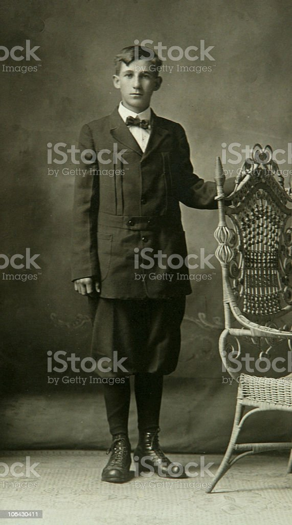 antique photograph of young boy in bloomers stock photo