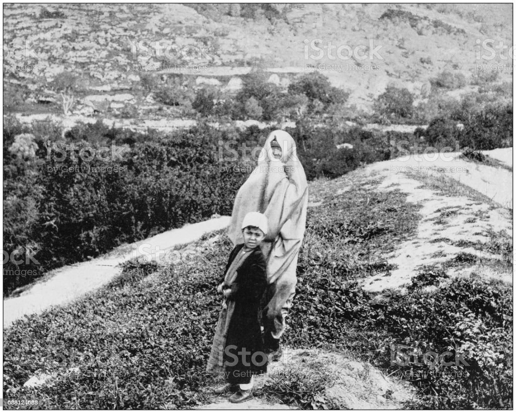 Antique photographs of Holy Land, Egypt and Middle East: Woman and boy of Samaria stock photo