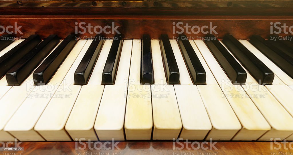 Antique piano keyboard shot with extremely wide-angle lens stock photo