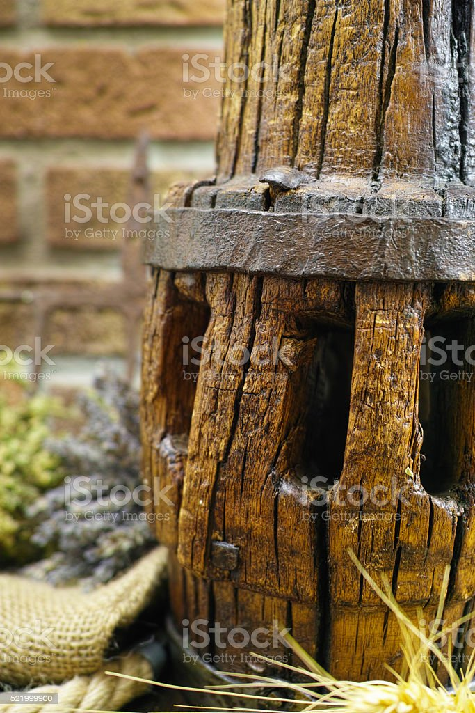 Antique pitchfork and wooden wheel hub close up stock photo