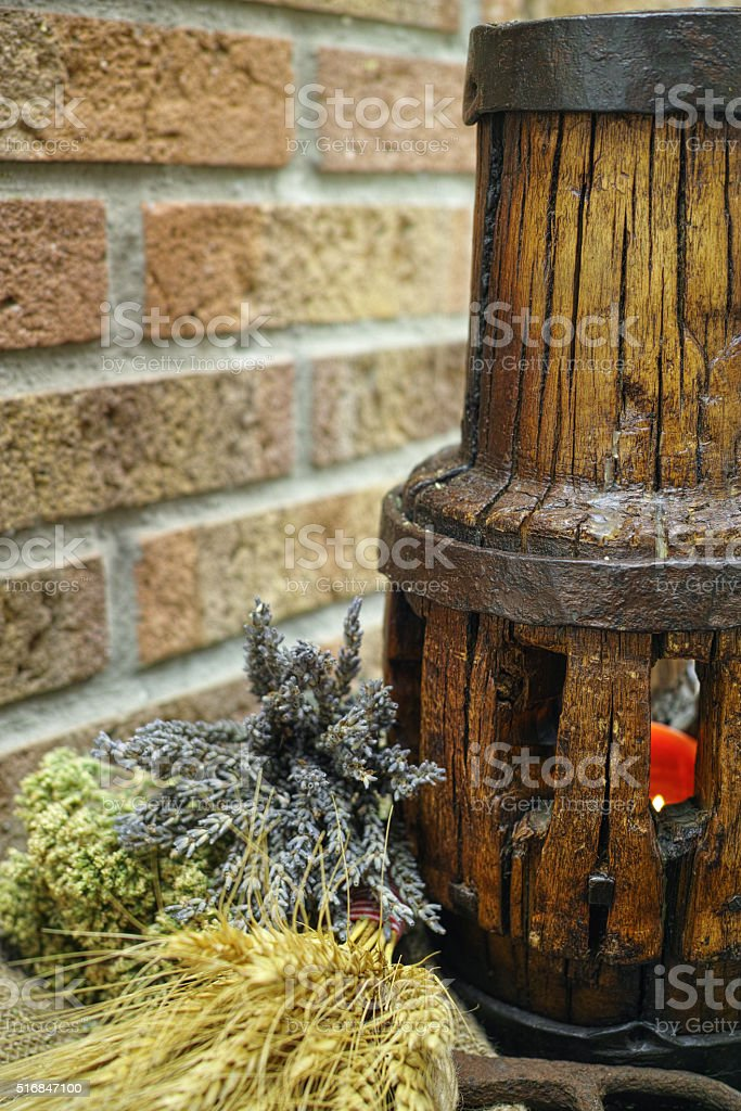 Antique pitchfork and wooden wheel hub stock photo
