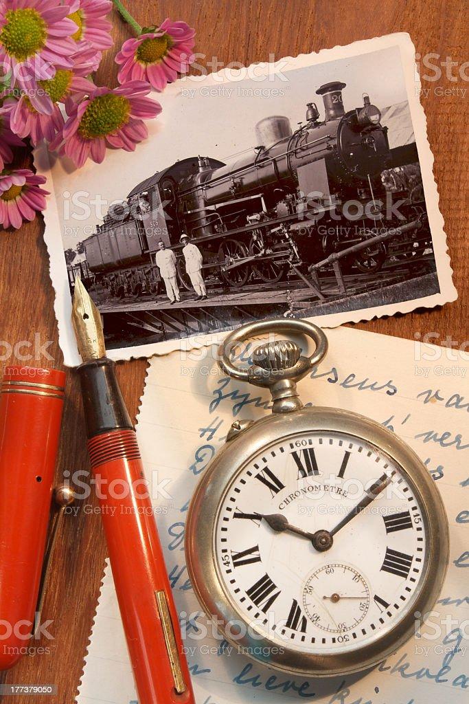 Antique pocket watch, nostalgic photo and fountain pen royalty-free stock photo