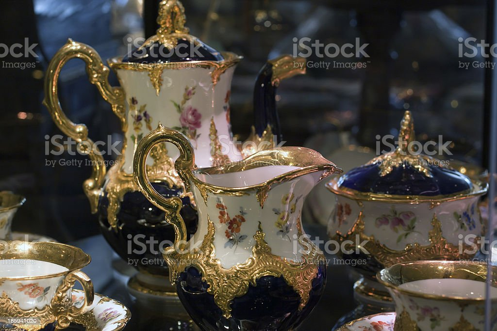 Antique porcelain coffee set in show case stock photo