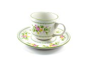 antique porcelain tea cup on white background