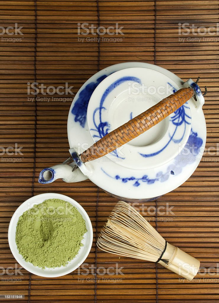 Antique porcelan teapot for green tea stock photo